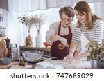 grandmother helping her... | Shutterstock . vector #747689029