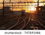 a train on the railroad tracks  ... | Shutterstock . vector #747691486