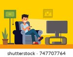man watching tv on sofa in home ... | Shutterstock .eps vector #747707764