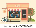 couple sitting in the cafe.... | Shutterstock .eps vector #747708460