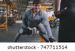 in the gym   athlete man... | Shutterstock . vector #747711514