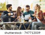 group of four friends having... | Shutterstock . vector #747712039