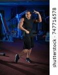 young male athlete bodybuilder... | Shutterstock . vector #747716578
