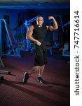 young male athlete bodybuilder... | Shutterstock . vector #747716614