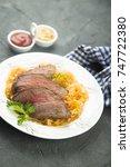 Small photo of Steak with sauerkraut