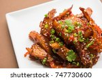 honey chilli potato wedges ... | Shutterstock . vector #747730600