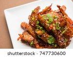 honey chilli potato wedges ... | Shutterstock . vector #747730600