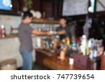 young man buy coffee in the... | Shutterstock . vector #747739654