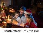 christmas night  a cheerful... | Shutterstock . vector #747745150