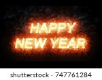 burning happy new year fire... | Shutterstock . vector #747761284