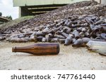 Glass Pile Brown Bottles  In...