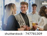coworkers are enjoying drinks... | Shutterstock . vector #747781309
