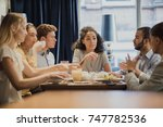 group of coworkers are having a ... | Shutterstock . vector #747782536