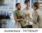 three male friends are enjoying ... | Shutterstock . vector #747782629