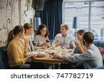 group of friends are eating... | Shutterstock . vector #747782719