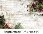 christmas background with fir... | Shutterstock . vector #747786544