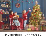 merry christmas and happy... | Shutterstock . vector #747787666