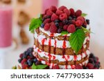 Small photo of holiday cakes and serve.sweet desserts with berries and fruits served on the table.Wedding cake from the fruit.Delicious sponge cake closeup.