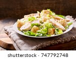 plate of chicken salad on a... | Shutterstock . vector #747792748