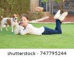 brunette little girl is lying... | Shutterstock . vector #747795244