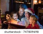 christmas night  a cheerful... | Shutterstock . vector #747809698