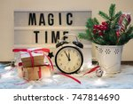 Small photo of Christmas composition with festive accoutrement and board with phrase, sentence magic time.