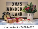 Small photo of Christmas composition with festive accoutrement and board with phrase, sentence xmas wonderland.