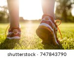 close up of sportswomen legs | Shutterstock . vector #747843790