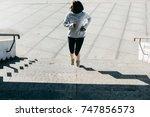 sport young women run on the... | Shutterstock . vector #747856573