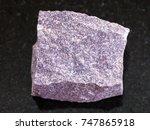 Small photo of macro shooting of natural mineral rock specimen - rough Alunite stone on dark granite background from Zaglik, Dashkasan region of Azerbaijan