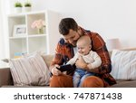 family  parenthood and people... | Shutterstock . vector #747871438