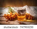 sea buckthorn oil and berries... | Shutterstock . vector #747903250