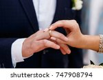 putting on wedding rings | Shutterstock . vector #747908794