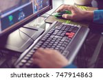 man's hands play pc game ... | Shutterstock . vector #747914863