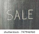sale word drawn on chalkboard