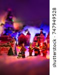 Small photo of Season Greeting. Fairytale miniature scenery with Miniature Singing In Choir Together, Christmas concept background