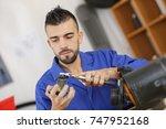 technician cleaning a motor part   Shutterstock . vector #747952168