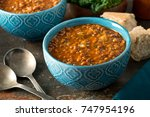 a bowl of delicious hearty... | Shutterstock . vector #747954196