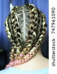 Small photo of a hairstyle made of thick braid with a kanekalon for a girl, five braids with an interlacing of artificial material. boxing braids, trends in hairstyles