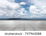 empty marble floor and green... | Shutterstock . vector #747963088