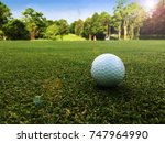 Golf Ball On Green In The...
