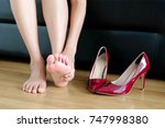 foot pain woman sitting ... | Shutterstock . vector #747998380