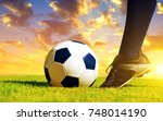 soccer ball with feet player on ... | Shutterstock . vector #748014190