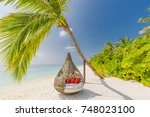 beautiful tropical maldives... | Shutterstock . vector #748023100