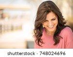 mature woman looking down. | Shutterstock . vector #748024696