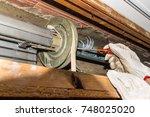 Rolling Shutter Repair. Worker...