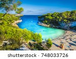 amazing beach of cala llombards ... | Shutterstock . vector #748033726
