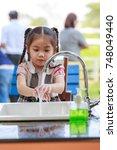 Little Girl  Washing Hands.