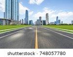 asphalt road through the modern ...   Shutterstock . vector #748057780