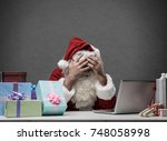 stressed frustrated santa claus ... | Shutterstock . vector #748058998